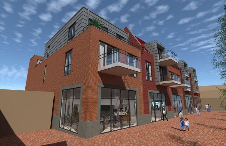 Nieuwbouw winkel Smit Tweewielers met 12 appartementen.